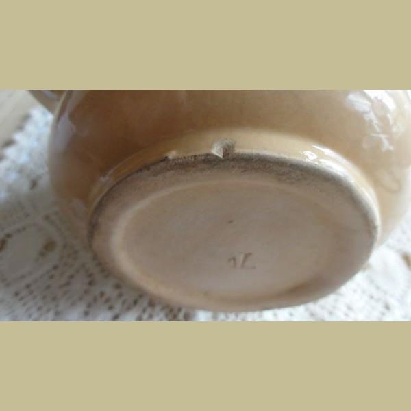 Brocante Keukenspullen : Keukenspullen > Brocante kan met spuitmotief bloemen