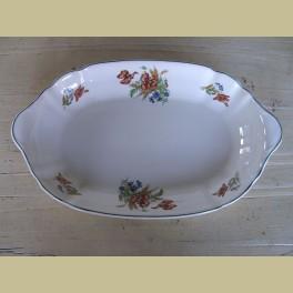 Schaal Societe Ceramique Maestricht met bloemen
