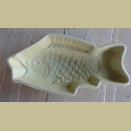 Oude pastel gele vis puddingvorm